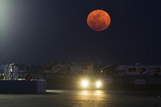 A super full moon rises over the back straight away during the 59th annual American Le Mans Series 12 Hours of Sebring auto race at the Sebring International Raceway Saturday, March 19, 2011 in Sebrin