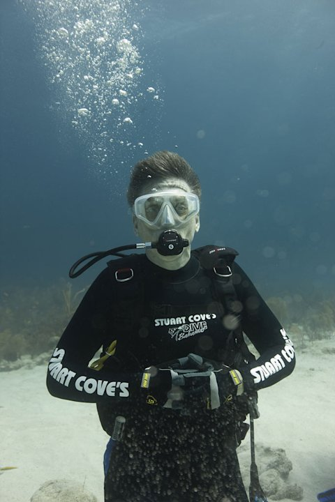 """Late Late Show"" host Craig Ferguson, wearing protective shark gear, after a shark dive in Nassau, Bahamas as seen on ""Shark Bites: Adventures in Shark Week."""