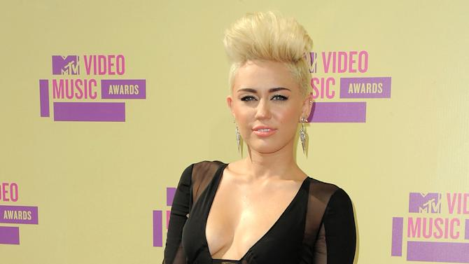 FILE - In this Sept. 6, 2012 file photo, Miley Cyrus attends the MTV Video Music Awards in Los Angeles. When Cyrus cut off the long hair her fans had become used to, she took some heat. She has said (and Tweeted) repeatedly, though, that she was pleased with the new punk-pixie look and was sticking with it.  (Photo by Jordan Strauss/Invision/AP, file)