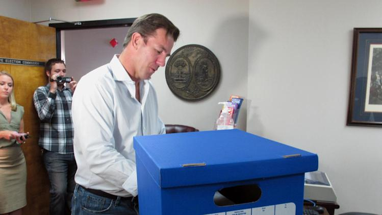Former South Carolina Treasurer Thomas Ravenel fills out paperwork Monday, July 14, 2014, at the state Election Commission headquarters in Columbia, S.C., to run as a petition candidate for the U.S. Senate seat held by Lindsey Graham. He also presented a box of signatures to get him on the ballot as an independent. Ravenel pleaded guilty to a cocaine charge that forced him to resign as treasurer in 2007 and he spent 10 months in prison. (AP Photo/Jeffrey Collins)
