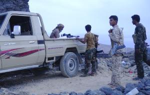 Armed Yemeni fighters loyal to President Abedrabbo…