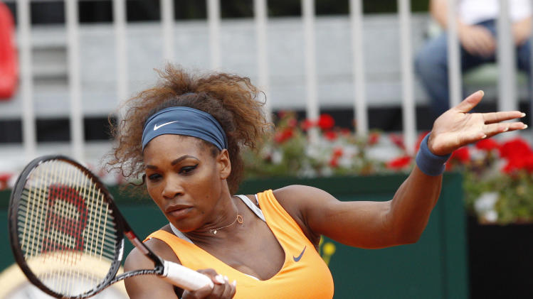 Serena Williams, of the United States, returns the ball to Slovakia's Dominika Cibulkova, during their match at the Italian Open tennis tournament in Rome, Thursday, May 16, 2013. (AP Photo/Riccardo De Luca)