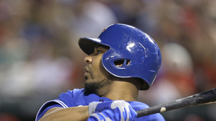 Toronto Blue Jays' Edwin Encarnacion watches his two-run RBI-double during the eighth inning of a baseball game against the Texas Rangers, Thursday, June 13, 2013, in Arlington, Texas. The Blue Jays won 3-1. (AP Photo/LM Otero)
