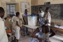 Poll workers count ballots after the end of voting in Mali's presidential elections in Timbuktu