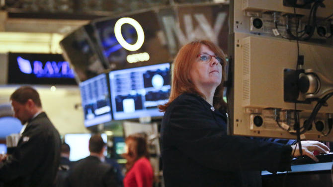 FILE - In this Feb. 20, 2013, file photo, Maureen Smaldone, a trader for Brendan E. Cryan and Company, monitors trading activity from her workstation at the New York Stock Exchange. The positive mood in financial markets showed few signs of abating Thursday March 7, 2013 ahead of policy statements from Europe's top two central banks. (AP Photo/Bebeto Matthews, File)
