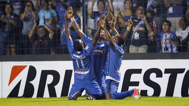 Ecuador's Emelec players celebrate scoring against Argentina's Velez Sarsfield during their Copa Libertadores match in Guayaquil