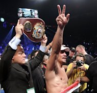 Juan Manuel Marquez waves to the crowd after knocking out Manny Pacquiao in the 6th round of their welterweight fight at the MGM Grand Garden in Las Vegas, Nevada