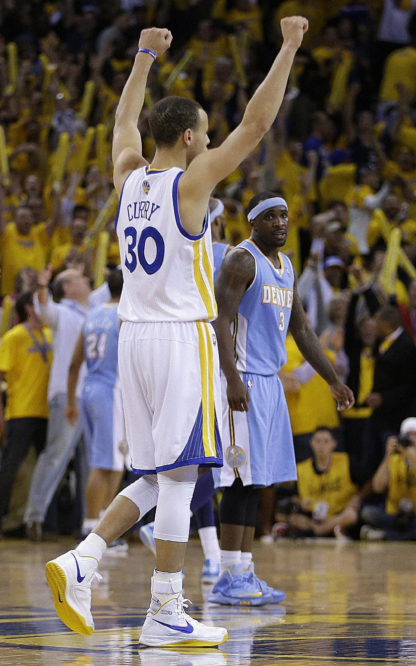 Golden State Warriors' Stephen Curry (30) reacts as Denver Nuggets' Ty Lawson watches, right, at the end of Game 3 in a first-round NBA basketball playoff series on Friday, April 26, 2013, in Oakland, Calif. (AP Photo/Ben Margot)