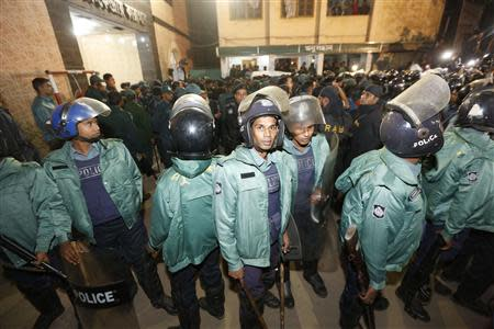 Police officers stand guard in front of the central jail in Dhaka.