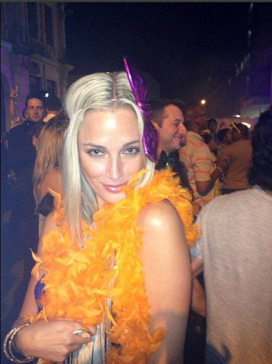 Reeva is dressed bright orange …