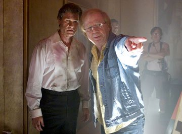 Kurt Russell and director Wolfgang Petersen on the set of Warner Bros. Pictures' Poseidon