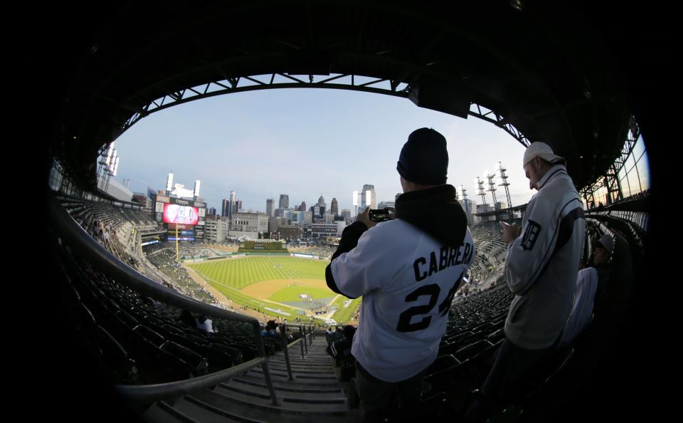 Fans arrive for Game 3 of the American League championship series between the Detroit Tigers and New York Yankees Tuesday, Oct. 16, 2012, in Detroit. (AP Photo/Charlie Riedel)