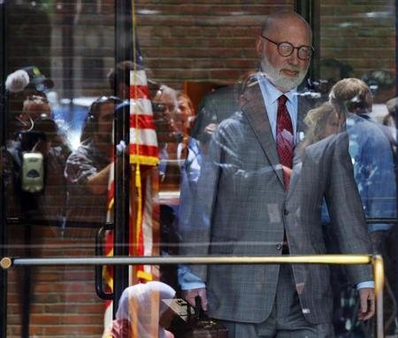 "Reporters and television cameras are reflected in the glass doors as J.W. Carney, defense attorney for accused mob boss James ""Whitey"" Bulger, leaves the U.S. Federal Courthouse at the end of first da"