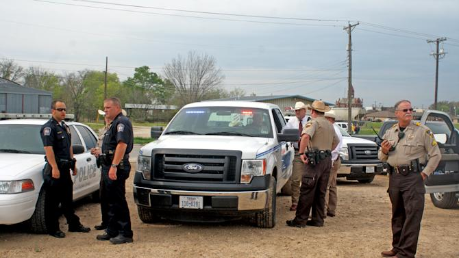 Hopkins County law enforcement officers set up a command center Tuesday morning, April 2, 2013 in Sulphur Springs, Texas, to expand the manhunt for capital murder suspect Brian Allen Tucker and John Marlin King, who escaped from the Hopkins County Jail. (AP Photo/Sulphur Springs News-Telegram, Luis Noble) MANDATORY CREDIT
