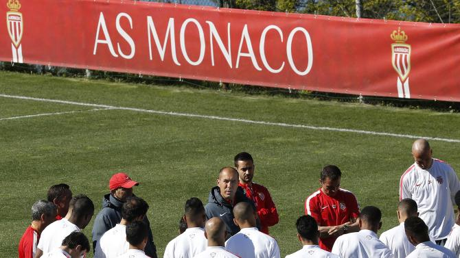 AS Monaco's coach Leonardo Jardim talks to players during a training session on the eve of their Champions League soccer match against Juventus in La Turbie