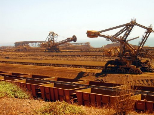<p>File photo taken in 2010 shows iron ore carriers at Rio Tinto's Dampier port in Western Australia. Australian PM Julia Gillard Tuesday denied claims that the mining boom was over, saying its benefits would last decades even as a key forecaster warned more projects may be shelved.</p>