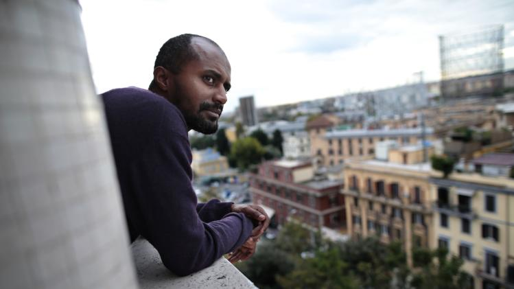 Director Dagmawi Yimer from Ethiopia looks on as he stands in a balcony in downtown Rome