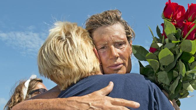 In this photo provided by the Florida Keys News Bureau, endurance swimmer Diana Nyad, right, is hugged by crew member Vanessa Linsley after arriving in Key West, Fla., Tuesday, Aug. 21, 2012. Nyad failed in a fourth attempt to complete a swim across the Florida Straits from Cuba to the Florida Keys. The 63-year-old Nyad said she was disappointed but didn't feel there was anything she could have done better. (AP Photo/Florida Keys News Bureau, Andy Newman)