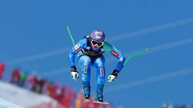 Slovenia's Tina Maze speeds down the course on her way to place fourth in an alpine ski World Cup women's downhill race, in Meribel, France, Saturday, Feb. 23, 2013. (AP Photo/Marco Trovati)