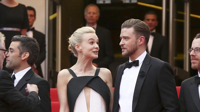 """FILE - This May 19, 2013 file photo shows actress Carey Mulligan, left, in a Deco-inspired white and black gown with keyhole opening with Justin Timberlake at the screening of """"Inside Llewyn Davis"""" at the 66th international film festival, in Cannes, southern France. (Photo by Joel Ryan/Invision/AP, file)"""