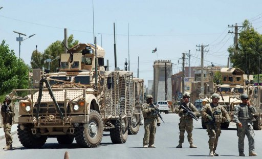 <p>US soldiers stop traffic after a terror attack in Kandahar on April 28. A suicide car bomb attack outside a university in southern Afghanistan killed at least seven people and wounded more than 20, Afghan officials told AFP.</p>