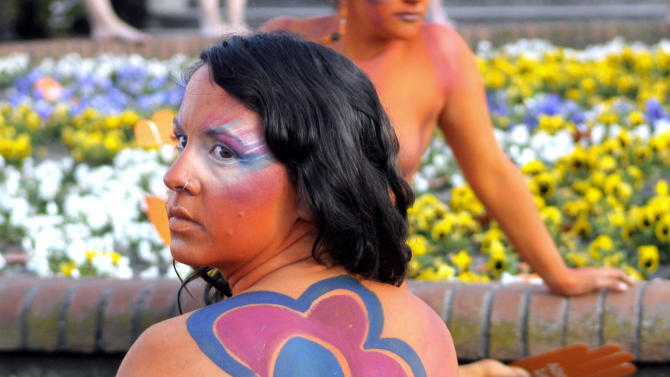 "A pro abortion activist, with her body painted, demonstrates in front of the Uruguayan congress in Montevideo, Uruguay, Tuesday, Sept. 25, 2012. Uruguay's congress appeared ready on Tuesday to legalize abortion, a groundbreaking move in Latin America, where no country save Cuba has made abortions accessible to all women during the first trimester of pregnancy. The sign reads in Spanish ""legal abortion.""  (AP Photo/Matilde Campodonico)"