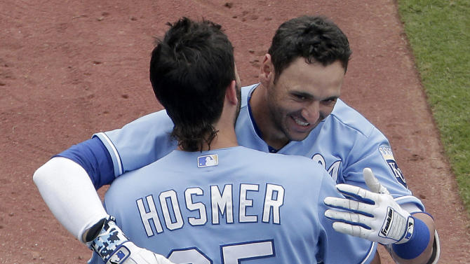 Kansas City Royals' Paulo Orlando celebrates with Eric Hosmer (35) after Orlando hit a walk-off grand slam during the ninth inning of the first game in a baseball doubleheader against the Tampa Bay Rays Tuesday, July 7, 2015, in Kansas City, Mo. The Royals won 9-5. (AP Photo/Charlie Riedel)