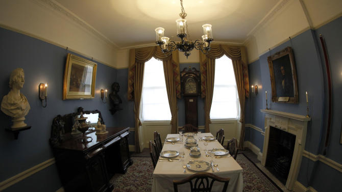 "The dining room of Charles Dickens' home, part of the Charles Dickens Museum in London, Wednesday, Dec. 5, 2012. For years, the four-story brick row house where the author lived with his young family was a dusty and slightly neglected museum, a mecca for Dickens scholars but overlooked by most visitors to London. Now, after a 3 million pound ($4.8 million) makeover, it has been restored to bring the writer's world to life. Its director says it aims to look ""as if Dickens had just stepped out."" (AP Photo/Sang Tan)"
