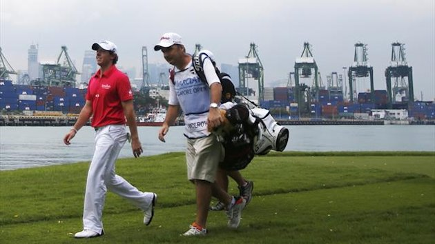 Rory McIlroy of Northern Ireland walks down the sixth fairway during the first round of the Barclays Singapore Open golf tournament in Sentosa