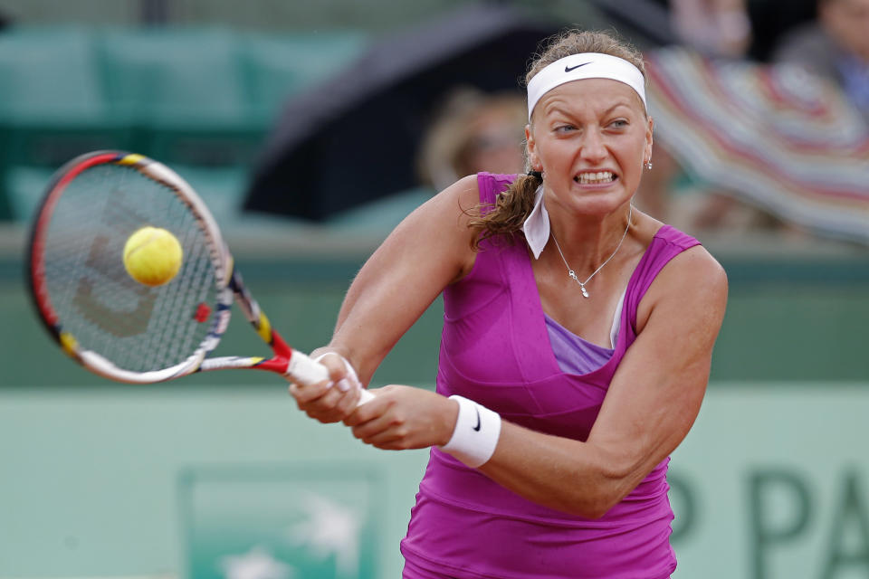 Petra Kvitova of the Czech republic returns in her quarter final match against Yaroslava Shvedova of Kazakhstan at the French Open tennis tournament in Roland Garros stadium in Paris, Wednesday June 6, 2012. Kvitova won in three sets 3-6, 6-2, 6-4. (AP Photo/Michel Euler)