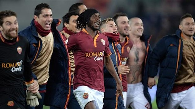 Roma's Gervihno celebrates with team-mates (AFP)