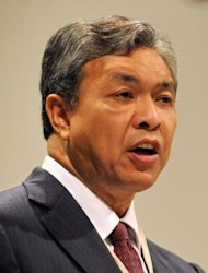 <p>Malaysian Defence Minister Ahmad Zahid Hamidi speaks during the Asia-Pacific security forum in Singapore in 2010. A scandal linking Malaysia's leader, a young woman's murder and alleged kickbacks in a French submarine deal has resurfaced as a potential danger for the government as elections loom.</p>