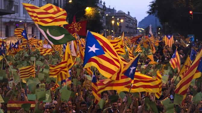 "FILE - Demonstrators wave Catalan flags during a protest rally in Barcelona , Spain, in this Tuesday, Sept. 11, 2012 file photo. Thousands of people demonstrated in Barcelona on Tuesday demanding independence for Catalonia, on the Catalonia region's 'National Day"". On Thursday, regional lawmakers voted to hold a referendum for Catalonia's seven million citizens to decide whether they want to break away from Spain. The Spanish government says that the referendum would be unconstitutional. And it's unclear if the ""Yes"" vote would win — even in these restless times. But it looks more likely than ever that Catalonia may ask to go its own way. (AP Photo/Emilio Morenatti, File)"
