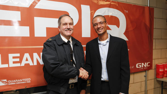 FDNY Chief John Bley shakes the hand of Director of Brand Management Sports Nutrition for EPIQ Brent Coward at EPIQ Thank You In Relief of Sandy on Tuesday, February 5, 2013 in New York City. (Photo by Amy Sussman/Invision for EPIQ/AP Images)