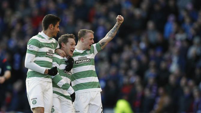 Celtic's Commons celebrates, with Griffiths and Bitton, his goal against Rangers during their Scottish League Cup semi final match in Glasgow, Scotland