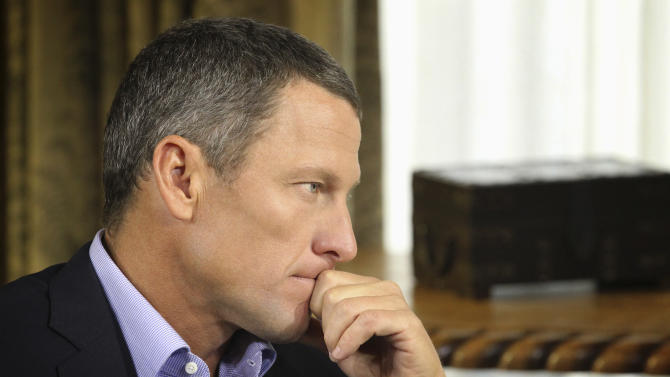 "FILE - In this Jan. 14, 2013, file photo provided by Harpo Studios Inc., Lance Armstrong listens as he is interviewed by talk show host Oprah Winfrey during taping for the show ""Oprah and Lance Armstrong: The Worldwide Exclusive"" in Austin, Texas. Armstrong on Wednesday, Feb. 6, was given more time to think about whether he wants to cooperate with the U.S. Anti-Doping Agency. Separately, he learned that he's about to be sued. (AP Photo/Courtesy of Harpo Studios, Inc., George Burns, File)"