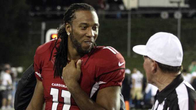 Arizona Cardinals wide receiver Larry Fitzgerald (11) talks with referee Craig Ochoa (73) during the third quarter of the Hall of Fame exhibition football game against the New Orleans Saints, Sunday, Aug. 5, 2012 in Canton, Ohio. The Saints won 17-10.(AP Photo/Scott Galvin)