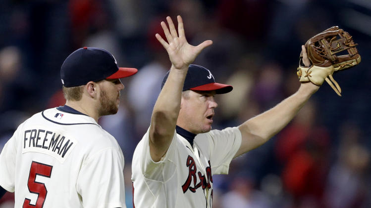 Atlanta Braves' Chipper Jones, right, celebrates with teammate Freddie Freeman after the Braves defeated the Washington Nationals 5-1 in a baseball game Sunday, Sept. 16, 2012, in Atlanta. (AP Photo/David Goldman)