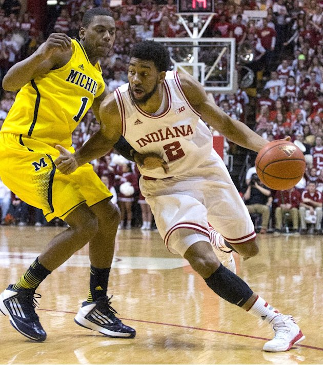 Indiana's Christian Watford (2) drives the ball up court against Michigan's Glenn Robinson III (1) during the second half of an NCAA college basketball game Saturday, Feb. 2, 2013, in Bloomington, Ind