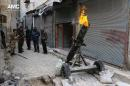 FILE - In this Sunday Feb. 15, 2015 file photo and provided on by the Syrian anti-government activist group Aleppo Media Center (AMC), which has been authenticated based on its contents and other AP reporting, shows Syrian rebels firing locally made shells against the Syrian government forces, in Aleppo, Syria. Islamic State militants entered a Syrian opposition stronghold in the country's north on Saturday, clashing with rebels on the edges of the town as the extremist group built on its most significant advance near the Turkish border in two years, Syrian opposition groups and IS media said. (AP Photo/Aleppo Media Center, AMC, File)