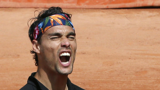 Fabio Fognini of Italy reacts during the men's singles match against Japan's Tatsuma Ito at the French Open tennis tournament at the Roland Garros stadium in Paris