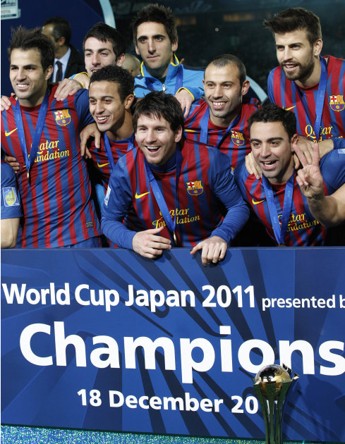 Spain's FC Barcelona midfielder Lionel Messi, center, and teammates celebrate on the podium after the victory over Brazil's Santos FC during the final at the Club World Cup soccer tournament in Yokoha