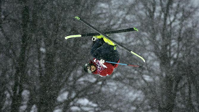 France's Kevin Rolland competes during the men's freestyle skiing halfpipe qualification at the Rosa Khutor Extreme Park, at the 2014 Winter Olympics, Tuesday, Feb. 18, 2014, in Krasnaya Polyana, Russia. (AP Photo/Jae C. Hong)