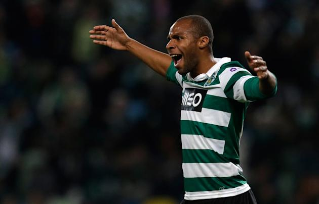 Sporting's Wilson celebrates after scoring their third goal during their Portuguese league soccer match against  Belenenses Saturday, Dec. 14 2013, at Sporting's Alvalade stadium in Lisbon