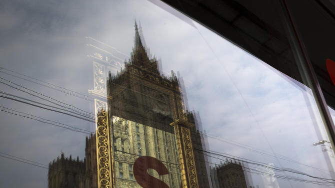 "The Russian Foreign Ministry headquarters seen reflected in a shop window in Moscow on Thursday, Oct. 4, 2012.  US prosecutors allege that naturalized U.S. citizen  Alexander Fishenko and six others ""engaged in a surreptitious and systematic conspiracy"" to obtain highly regulated technology from U.S. makers and sold them to Russian authorities. Fishenko and six others charged in the alleged scheme are expected to appear Thursday morning in U.S. Houston federal court.  (AP Photo/Alexander Zemlianichenko)"