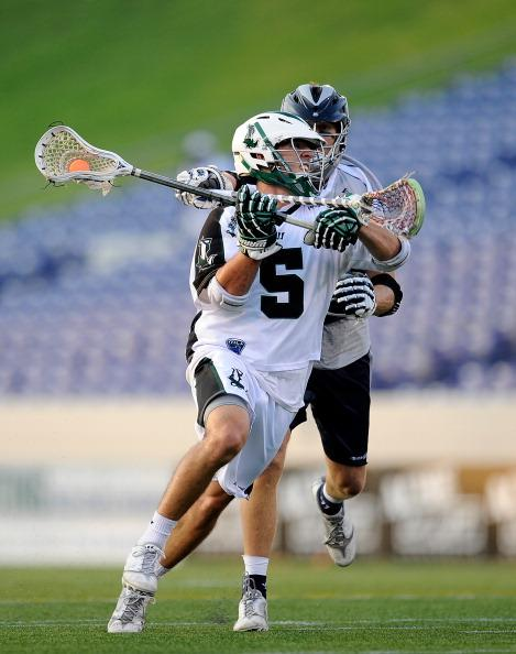William Mangan #5 of the Long Island Lizards eludes John Orsen #56 of the Chesapeake Bayhawks during a game at Navy-Marines Memorial Stadium on August 4, 2012 in Annapolis, Maryland. (Photo by Patrick McDermott/Getty Images)