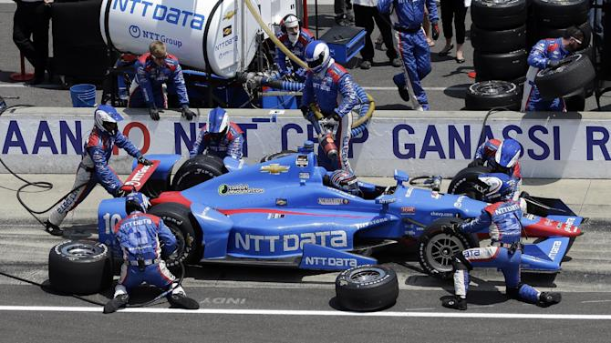 Tony Kanaan, of Brazil, makes a pit stop during the 99th running of the Indianapolis 500 auto race at Indianapolis Motor Speedway in Indianapolis, Sunday, May 24, 2015.  (AP Photo/AJ Mast)