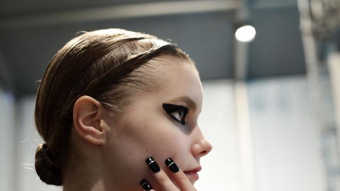 A model prepares backstage before the Falguni Peacock Autumn/Winter 2013 collection runway show during New York Fashion Week