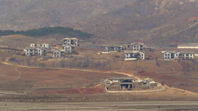 """North Korea's town Kaepoong  is viewed from the unification observation post near the border village of Panmunjom, that has separated the two Koreas since the Korean War, in Paju, north of Seoul, South Korea, Saturday, March 30, 2013. North Korea issued its latest belligerent threat Saturday, saying it has entered """"a state of war"""" with South Korea a day after its young leader threatened the United States because two American B-2 bombers flew a training mission in South Korea. (AP Photo/Lee Jin-man)"""