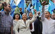 Exiled Uighur leader Rebiya Kadeer (C) holds a rally to protest against the Chinese government in Tokyo in May 2012. China came under fire Wednesday for deteriorating human rights as US officials and lawmakers said life for activists and bloggers in the communist nation was worsening